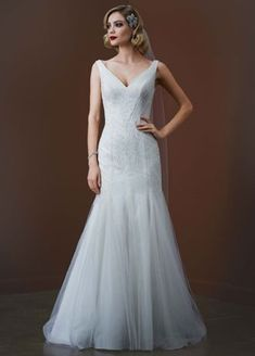 Effortlessly beautiful, you will enthrall everyone as you walk down the aisle in this gorgeous wedding dress!  Slim tank tulle mermaidgown features ultra-feminine deep v neckline.  Contoured vertical beading makes this gown even morespecial.  Sweep train. Sizes 0-14. Ivory available in stores and online.  Fully lined. Imported polyester. Back zip. Dry clean only.  TStyle: SPK583 $300