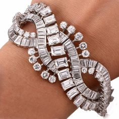 Estate Emerald-cut & Round Diamond Platinum Bracelet Item #: 639209 by DoverJewelry on Etsy https://www.etsy.com/listing/292528669/estate-emerald-cut-round-diamond