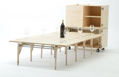 folding mobile dining table http://dornob.com/small-space-big-appeal-folding-dining-table-storage/#axzz2iwJaIDNh