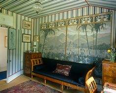 A grisaille papier peint is displayed in panels against the blue and white striped wallpaper of this tented dressing room in England ~ Tom Helme