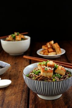 Golden pan-fried tofu, mixed with soba noodles and a sesame-soy dressing, sprinkled with sesame seeds and fresh spring onions, all in one delicious bowl.