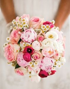Chamomile adds that just-picked look to this bouquet of peonies, ranunculus, roses and poppies.