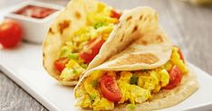 Start your day with this recipe for easy Breakfast Tacos. Cherry tomatoes provide a burst of flavor. Kid-friendly. Vegetarian. Delicious.