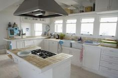 How To Clean Laminate Kitchen Cabinets