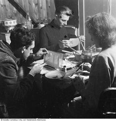 """1942 - 1945. Three members of a group of artists which together established the """"illegal"""" personal identification card center (PBC) to make false identity papers during the nazi occupation. Photo Nederlands Fotomuseum / Molette Cornelius. #amsterdam ##worldwar2"""