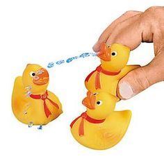 Rubber Ducky Squirts :   Toss several of these cute ducks into the pool during your summertime parties!   Assorted Designs; 5.08cm  Duckies do not float upright.  Price is per rubber ducky.