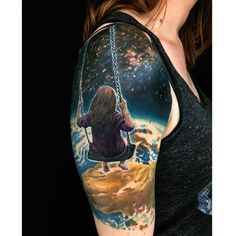 Cannot help but be amazed at this tattoo! The imagery of the little girl swinging from outer space while gazing at the earth below.....just wow. By Ryan Flaherty