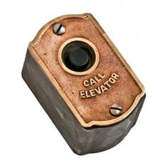 original early 20th century self-contained cast bronze and iron chicago loft building service elevator push button plaque with original black enameled case and bakelite button