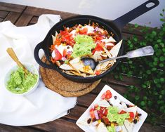 VEGAN LOADED NACHO SKILLET - I am a huge fan of Friday night movie nights. With our old flat, we would often spend cold winter evenings wrapped in cosy blankets, watching movies or documentaries. Some of my favourite things to watch with the flat were the Bridget Jones series, and Planet Earth documentaries. Are you guys familiar with the Danish… Vegan Food, Vegan Recipes, Baked Nachos, Fried Beans, Nacho Chips, Bridget Jones, Large Tray, Movie Nights, Vegan Cheese