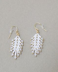 CLEARANCE - Swarovski Angel Feather earrings - Women's style: Patterns of sustainability Big Gold Hoop Earrings, Plastic Earrings, Seed Bead Earrings, Feather Earrings, Women's Earrings, Statement Earrings, Bead Jewellery, Beaded Jewelry, Beaded Necklace