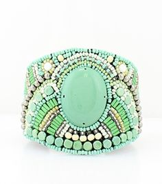 A beautiful Soft Felt Resin, Beaded cuff style bracelet to go with every outfit and occasion.