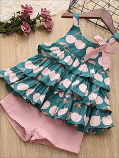 This tiered ruffled sleeveless top and pink shorts are full of intricate details and major style! Perfect for any and all spring occasions. Available in 2 lovely colors. Order 1 size up Poly/Spandex Hand wash cold water, hang dry Imported Cotton Frocks For Kids, Frocks For Girls, Frocks For Babies, Baby Girl Frocks, Kids Dress Wear, Kids Gown, Kids Wear, Girls Frock Design, Baby Dress Design