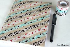 Washi tape love for a notebook - tutorial over at sewdelicious.blogspot.com