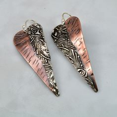 Stamped & Textured Mixed Metal Copper and Silver Solder Long Slim Heart Earrings by DebeVanderHeide on Etsy https://www.etsy.com/listing/509767699/stamped-textured-mixed-metal-copper-and
