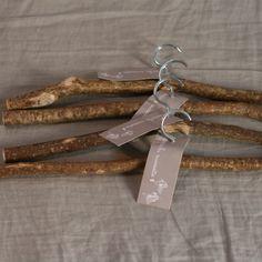 linen and milk — rustic hangers DIY? Wire hangers and twigs...sandpaper...done.