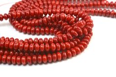 red bamboo coral 8x5mm smooth rondelle grade A quality 15 inch   See more coral beads here: https://www.etsy.com/shop/SelectBeads/search?search_query=coral+&order=date_desc&view_type=gallery&ref=shop_search  Shop home: https://www.etsy.com/shop/SelectBeads