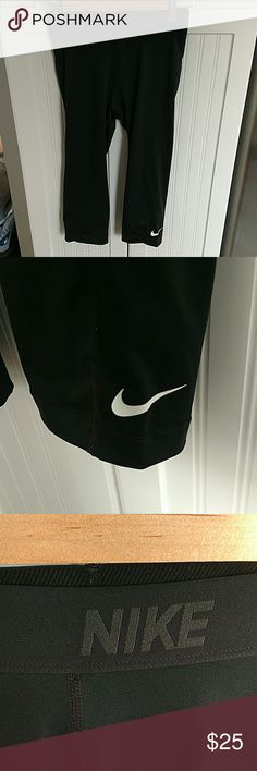 Nike dry fit crops Nike dry fit crops all black with white logo on leg. Has black on black elastic waist band. In excellent condition size medium Nike Pants