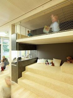 !Ideas!...This gives me ideas. Don't exactly like this room, but could do the carpeted platform idea with loft above and pullout train table below integrated into the step. This could double as a rockin' cool sleepover location and use all 9' of our verticle space. :) Kids School and Play Zone...