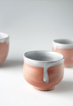 Wheel thrown ceramic cup with terra sigillata and white glaze. Made by Ingrid Wens.