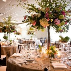 Elevated floral, with pink and raspberry peonies,white  hydrangea, green viburnum, garden roses, tulips, and lisianthus.