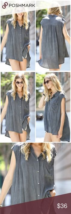Black Gray Button Down Sleeveless Tunic Top Black Gray Button Down Sleeveless Tunic Top featuring buttons and V neck color. Perfect to pair with leggings, jeans or shorts. Boutique Tops