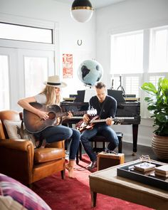 To play up the living room's abundant natural light, Holly skipped curtains and painted the walls a crisp white. In the corner, a baby grand piano inspires family jam sessions.