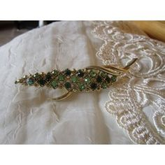 """New Listing Started vintage goldtone floral brooch with lovely green/dark green stones 3.1/2""""long £2.50"""