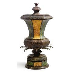 An Italian neoclassical painted tôle cistern 19th century of octagonal outline with molded lid, the tapered cistern fitted with  spouts above a conforming base, painted to simulate a variety of marbles Sotheby's