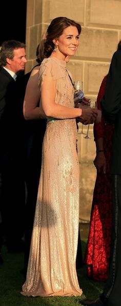 The sun shining softly on a sparkling Kate. The Duke and Duchess of Cambridge attend a gala dinner in support of East Anglia's Children's Hospices' nook appeal at Houghton Hall on June 22, 2016 in King's Lynn, England.