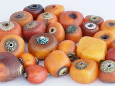 Antique natural amber beads with metal caps on the ends. Mauritania
