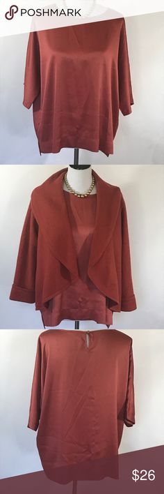 🎉Chico's orange top size 2 or large Chico's rust orange top size 2 or large. This simple top will be a beautiful addition to your wardrobe. The coat in the pictures is also for sale. Please see pics for garment measurements and details. Thanks for visiting my closet! Chico's Tops