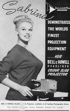 Sabrina demonstrates the world's finest projection equipment... her Bell & Howell Headliner Colour Slide Projector.