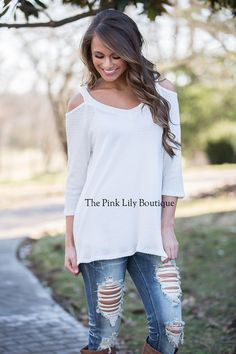 You are one call away from owning the best cold shoulder top ever! This one has a textured material and a flattering v-neck! It doesn't get much better than this blouse!