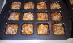 """mini individual lasagnas in Pampered Chef's new """"brownie pan"""". I used medium square ravioli (2 for each) along with some pasta sauce and mozzarella cheese. Bake 15 minutes at 375 degrees... www.pamperedchef.biz/karlene"""