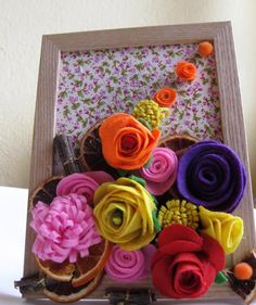 This is my own design of felt flower picture. Its a perfect gift for any occasions ,for any person. The normal frame (8/6 inches or -20/15sm),transforms to beautiful bouquet and gift in the same time. There are a different coloured flowers,some dried orange slices and a little cinnamon sticks.  In the process of crafting the frame we will keep the colours and proportions but the arrangement of the little flowers might be slightly different. For example the position of the red flower...