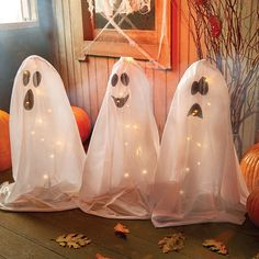 These 3 little Ghosts sit on your porch and twinkle with little lights – what a cute way to greet your trick-or-treaters.