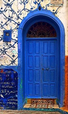 Beautiful Doors ~ Asilah, Morocco <<< Is it bad that I immediately thought this was a TARDIS??
