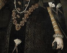 This detail shows the skirt and sleeves are extensively slashed. Each aglet is a work of beauty. The sleeves are tabbed just above the lace cuffs.