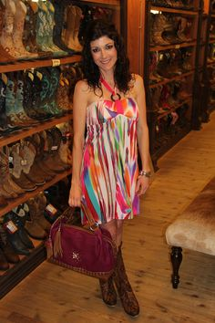 Date night! This fun, flirty multicolored Papillon dress goes great with your favorite cowboy boots and this magenta handbag from Sarah's Handbags and Accessories!