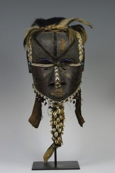 "Democratic Republic of the Congo; Kuba peoples Mask Wood, copper, cloth, leather, shells, beads H. 27.3 cm (10 3/4"") The University of Iowa ..."
