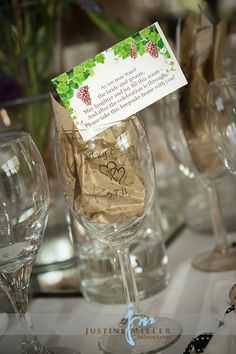 The second wedding favor - personalized wine glasses with a tag letting guests know they are a keepsake to take home