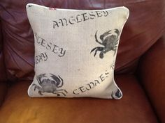 Cushion made from hand printed hessian and piped in Laura Ashley fabric.