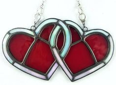 Check out this item in my Etsy shop https://www.etsy.com/listing/264700064/stained-glass-handcuff-hearts