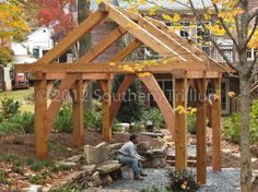 timber frame garden structure, outdoor living, woodworking projects, And for a sense of scale here is one of our crew sitting on the bench as we finished clean up