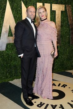 The light pink, off-the-shoulder Valentino dress with layers of ruffles gave Huntington-Whiteley a soft and feminine look while attending the Vanity Fair Oscars Party with her Bond-esque beau.