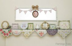Repurpose pretty vintage embroidered linens in eye catching frames atop a mantle decorated with vintage handkerchiefs, bunting style, to make yourself a super girly Vintage Spring Mantle by Flamingo Toes