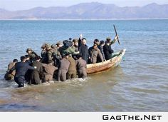 North Korean leader Kim Jong-Un waves from one of his naval ships