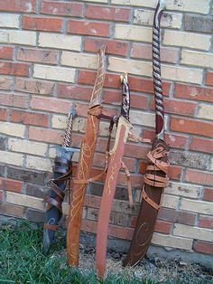 my elven armoury and scabbards, noble sting with scabbard, haldir's sword i made and scabbard i made, hadhafang and my scabbard, elven warrior sword and wood scabbard i made