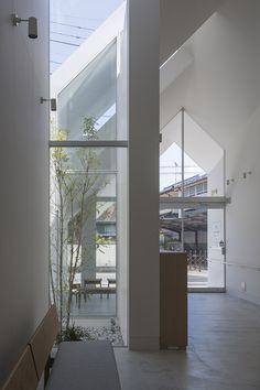 House-shaped Clinic Designed By Hkl Studio To Make Elderly Patients Feel More At Home - Minimalist Architecture, Japanese Architecture, Modern Architecture House, Sustainable Architecture, Architecture Details, Interior Architecture, Modern Houses, Pavilion Architecture, Residential Architecture