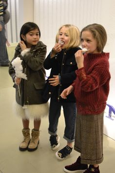 Mini me models having a quick break with a cotton candy treat at Pitti Bimbo in Florence, Italy. WGSN